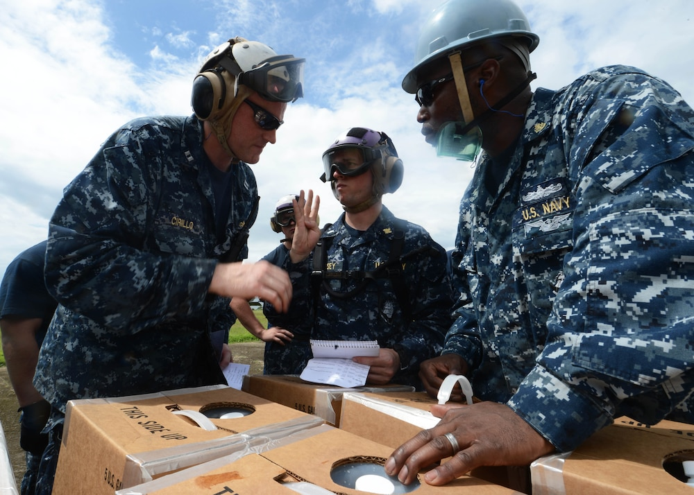 USS Mustin sailors provide aid during Operation Damayan