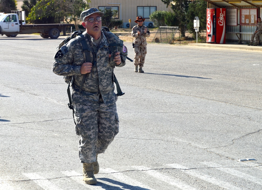 Deployed Soldiers conquer grueling road march