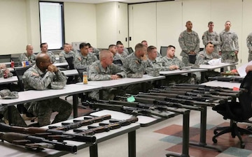 4th Brigade Combat Team, 1st Armored Division, leaders receive a brief from Army Special Operations Forces instructor
