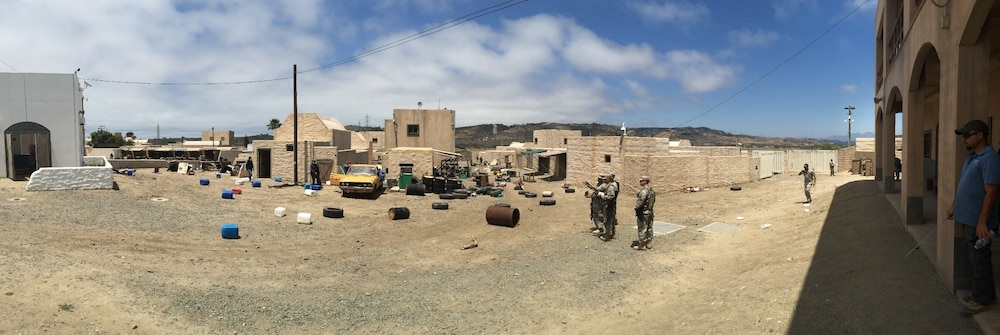 Soldiers from the 416th CA Bn. (Abn). conduct and area assessment of the damage to the simulated Philipipine city
