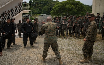 U.S. Marines, Republic of Korea Marines rehearse non-lethal crowd control tactics in South Korea