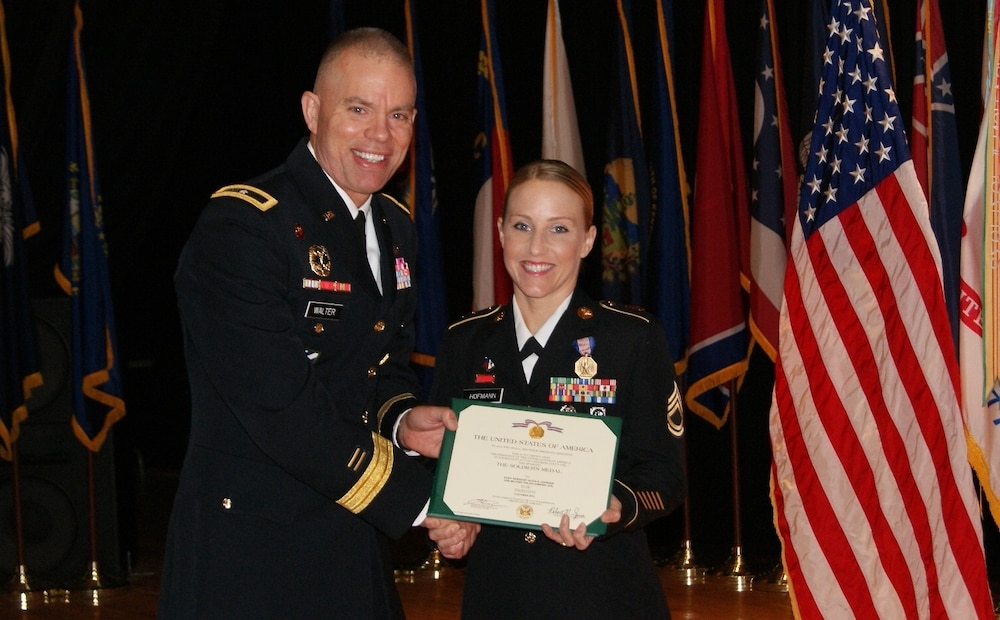 Brig. Gen. Walter Presents Soldiers Medal to Army Medic
