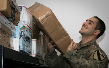 US Soldiers deliver mail, improve morale