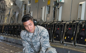 Port Dawgs secure equipment aboard C-17 aircraft