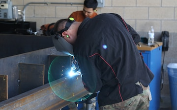 Army Engineer School Regimental CSM visits 602nd MSC welders.