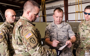 Army and Air Guardsmen work together on hurricane supply logistics