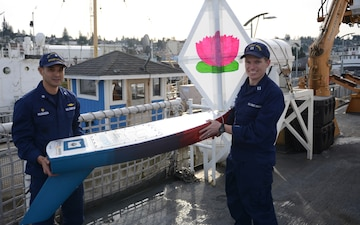CGC Steadfast presented with mini-boat from middle schoolers