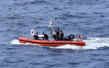 Coast Guard Cutter Steadfast launches the mini-boat Pacific Lotus