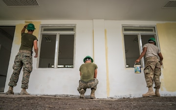 Balikatan 18: Multinational forces paint school building at Calangitan ES