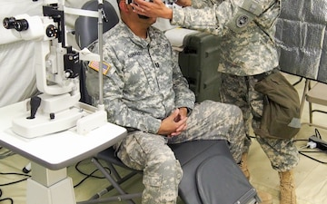 U.S. Army Reserve Soldier Capt. Amy Dao with 315th Optometry Medical Detachment, based in Fort Dix, N.J, prepares for an eye exam during Global Medic CSTX 91-18-01, at Fort Hunter Liggett, California, July 21, 2018. CSTX 91-18-01