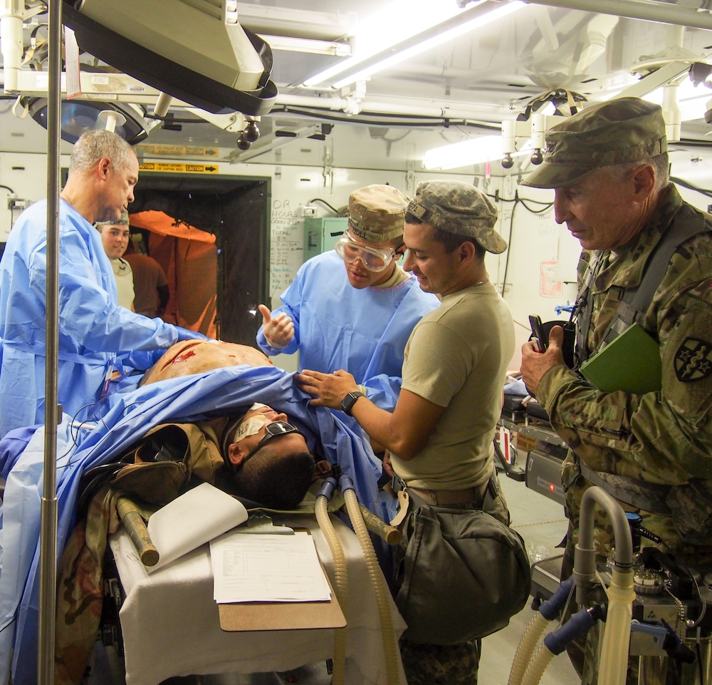 U.S. Army Reserve Soldiers assigned to 228th Combat Support Hospital, based out of San Antonio, Texas, provide medical care for a simulated patient in a Cut Suit during Global Medic CSTX 91-18-01