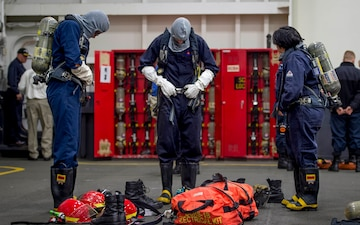 GHWB Sailors Don SCBA