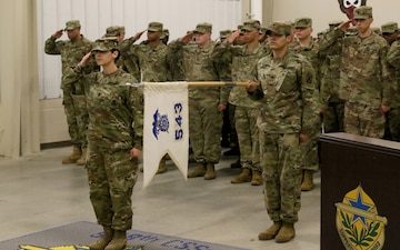 543rd cases their colors in preparation for their deployment in support of Operation Atlantic Resolve