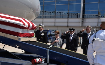 Navy Cdr. James B. Mills, accounted for from the Vietnam War, arrives to Reagan National Airport