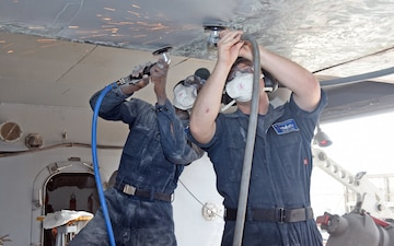 USS Blue Ridge Sailors perform corrosion control maintenance