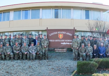 The Field Artillery Lessons Learned Working Group attendees gather for a group photo