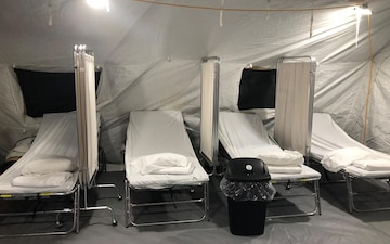 Patient Beds in a Surplus Military Tent