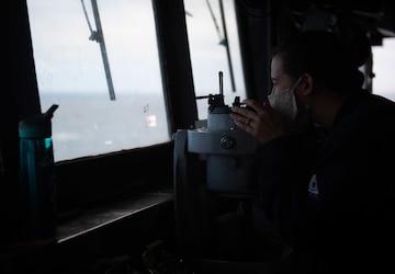 USS Princeton Sailor stands watch