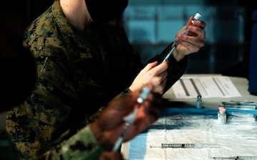 Deploying Marines and Sailors receive COVID-19 vaccine